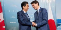 As tensions rise in the Asia-Pacific, Japan's PM is calling on Canada for help