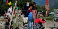 Schools reopen in Kashmir's main city but remain empty amid fears of continued unrest