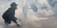 Hong Kong police use tear gas to counter protesters throwing petrol bombs, bricks