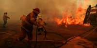 Australians shelter and flee as firefighters battle 150 bushfires